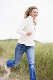 Woman running at beach smiling Royalty Free Stock Images