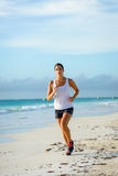 Woman running at beach Royalty Free Stock Photography