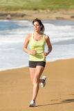 Woman running on beach Royalty Free Stock Image