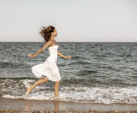 Woman running on the beach. Stock Images