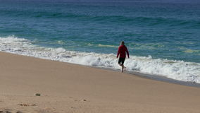 Woman Running on Beach with Waves. In the Background stock video footage