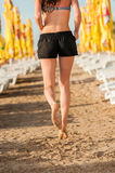 Woman running on beach. During work out training. Fit beautiful young female model jogging at sunrise Stock Images