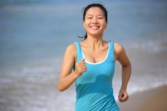 Woman running at beach Royalty Free Stock Photo
