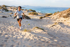 Woman running on beach Royalty Free Stock Photos