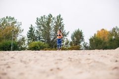Woman running on the beach. Young woman running on the beach, low angle view Royalty Free Stock Image