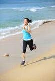 Woman running at beach Stock Image