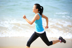 Woman running at beach Stock Photo
