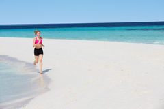 Woman Running On Beautiful Beach Stock Photo