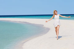 Woman Running On Beautiful Tropical Beach Stock Images