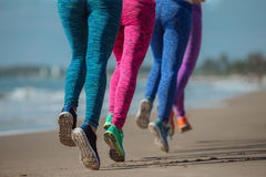 Woman running on the bech. Woman competing in a distance running on the bech Royalty Free Stock Image