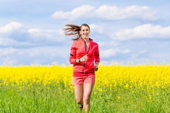 Woman running for better fitness in spring Stock Photos