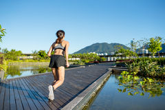 Woman running in a boardwalk Royalty Free Stock Images