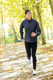 Woman running cheerful outside stock photography