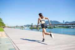 Woman running in a city Royalty Free Stock Photos