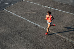 Woman running on city asphalt Stock Images