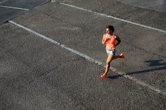 Woman running on city asphalt Stock Images