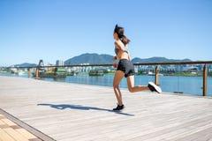 Woman running in city of Hong Kong Royalty Free Stock Photo