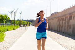 Woman running in the city park. Stock Image