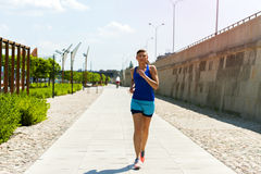 Woman running in the city park. Royalty Free Stock Photo