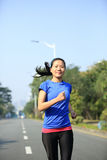 Woman running at city road Stock Photos