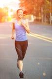Woman running at city road Stock Photography