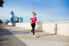 Woman running in the city Stock Photo