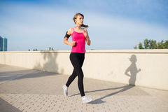 Woman running in the city Stock Photos