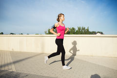 Woman running in the city Stock Image
