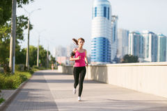 Woman running in the city Royalty Free Stock Image