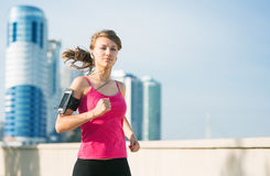 Woman running in the city Royalty Free Stock Photos
