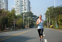 Woman running at city street Stock Photography