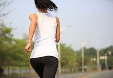 Woman running at city street Royalty Free Stock Photography