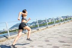 Woman running at city Stock Photo