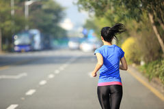 Woman running at city Stock Images