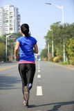 Woman running at city Royalty Free Stock Photo