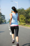 Woman running at city Royalty Free Stock Photography