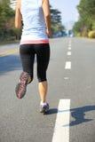 Woman running at city Stock Image