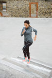 Woman running and climbing stairs Royalty Free Stock Image