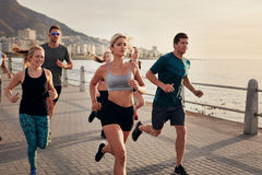 Woman with running club group stretching after a run Stock Photography