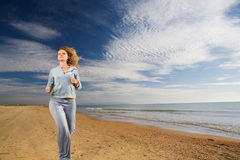 Woman running at coast Royalty Free Stock Image