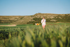 Woman running at country side Stock Photo