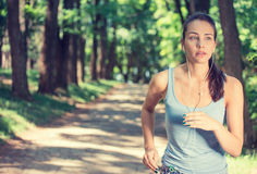 Woman running In countryside wearing earphones Royalty Free Stock Images