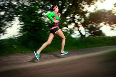 Woman running in the countryside Royalty Free Stock Photo