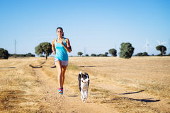 Woman running cross trail in countryside path Royalty Free Stock Photos