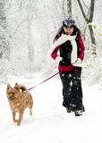 Woman running with dog Royalty Free Stock Photos