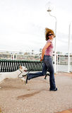 Woman running with dog Stock Images