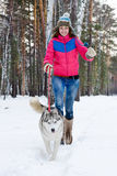 Woman running with dog Royalty Free Stock Photography