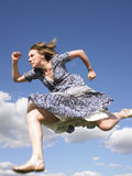 Woman Running in Dress Royalty Free Stock Images