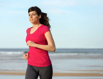 Woman working out on beach Stock Images