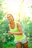 Woman running fast in forest Stock Photography